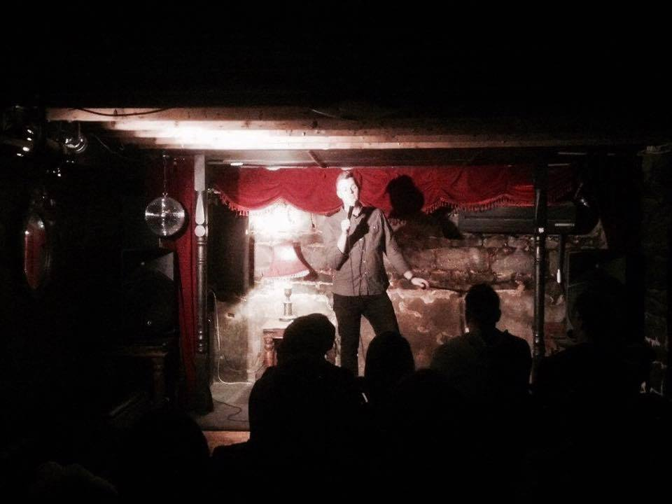 Comedian on stage at Dirty Secrets Comedy. Photo: Dirty Secrets Comedy