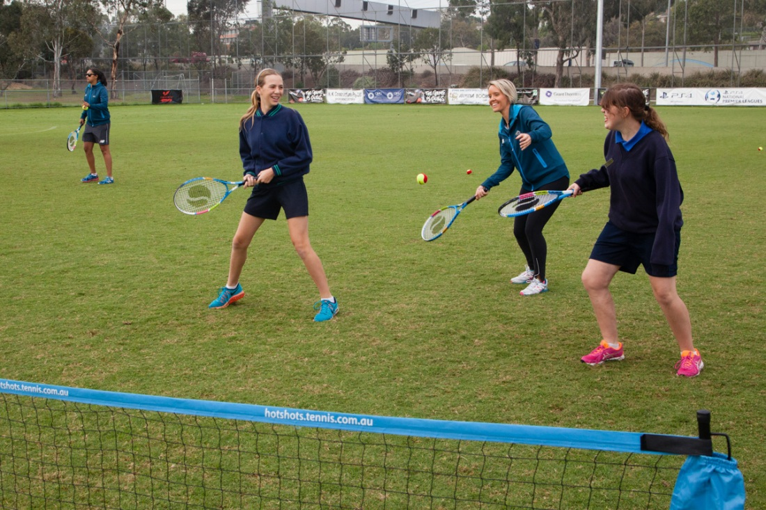 AAA Play participants playing tennis at Kevin Bartlett Reserve. Photo: AAA Play